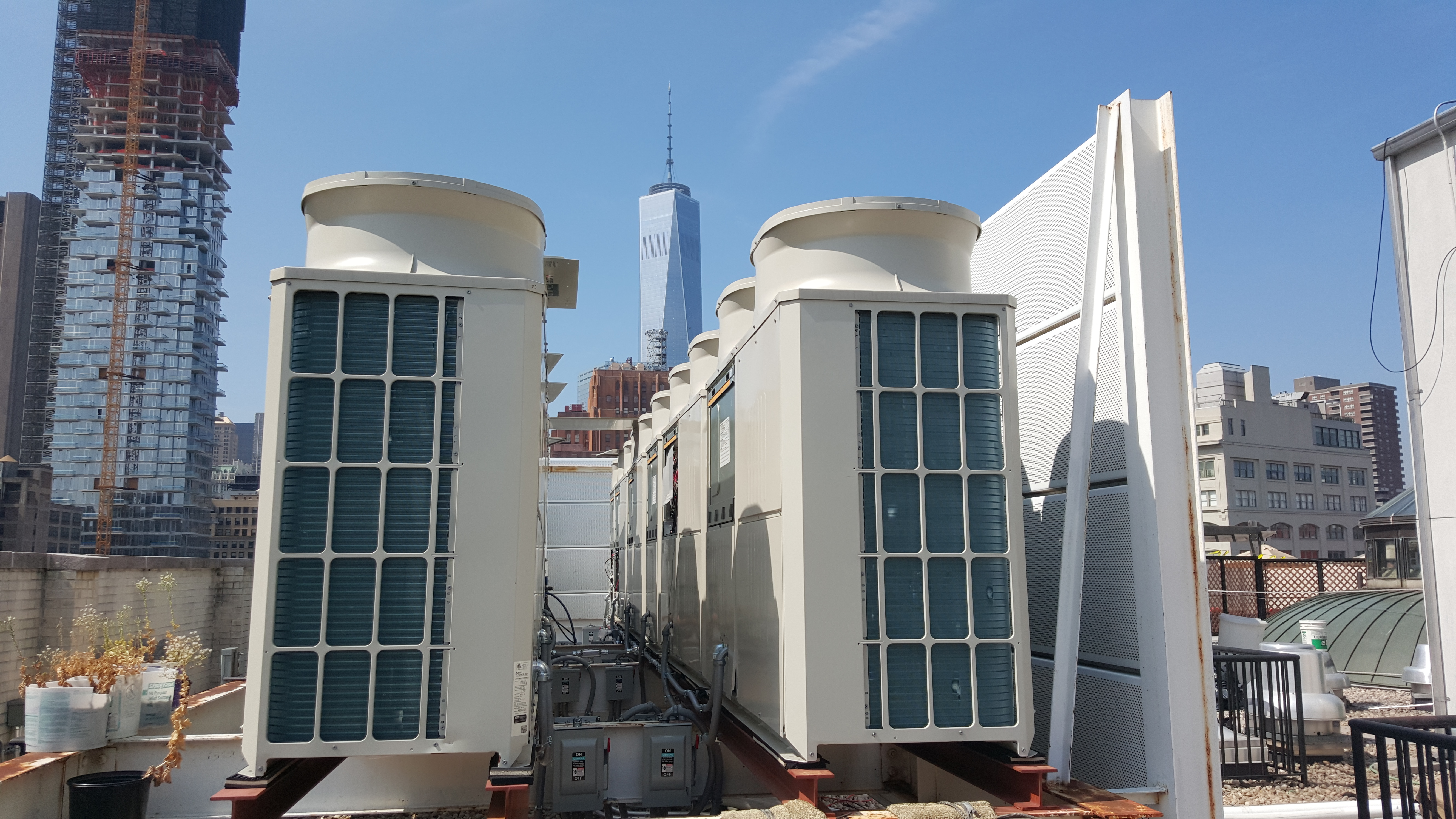 Mitsubishi City-Multi heat pumps on the roof of 260 West Broadway with the Freedom Tower in the background