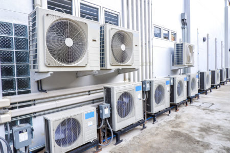 Air compressors for a commercial HVAC system outside of a building