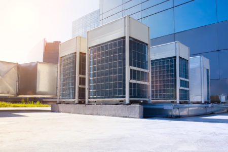 A commercial HVAC system on the roof of an office building