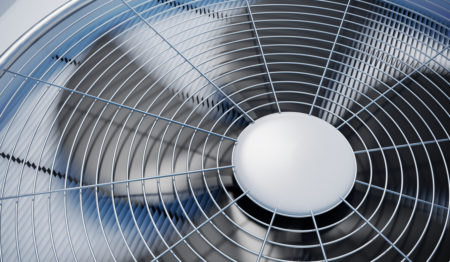 An HVAC fan functioning properly in an outside AC unit