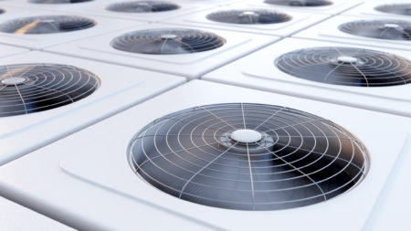 Close-up image of a row of commercial HVAC unit fans.