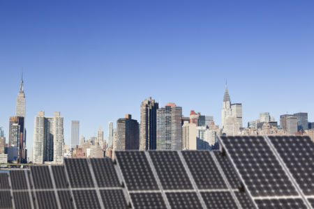 A solar installation for powering green HVAC in the foreground overlooking midtown Manhattan.